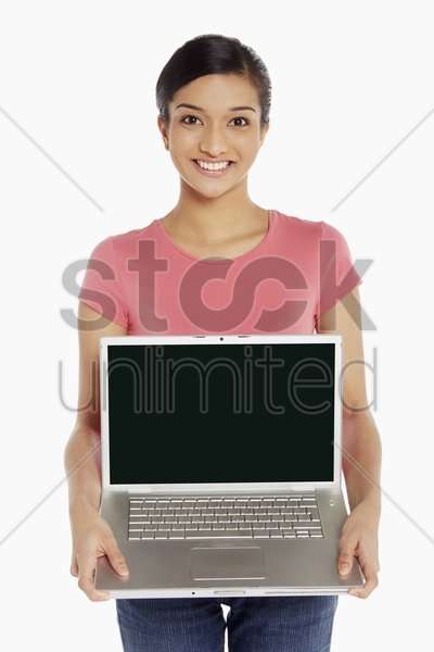 woman holding up laptop stock photo