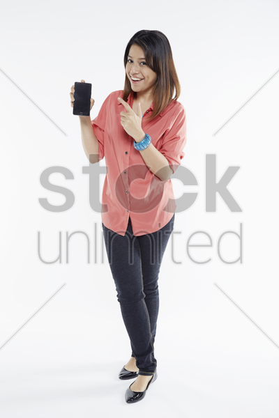 woman holding up mobile phone stock photo