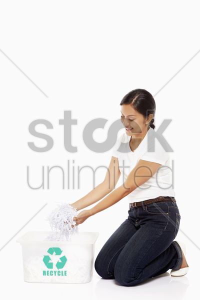 woman holding up shredded papers stock photo