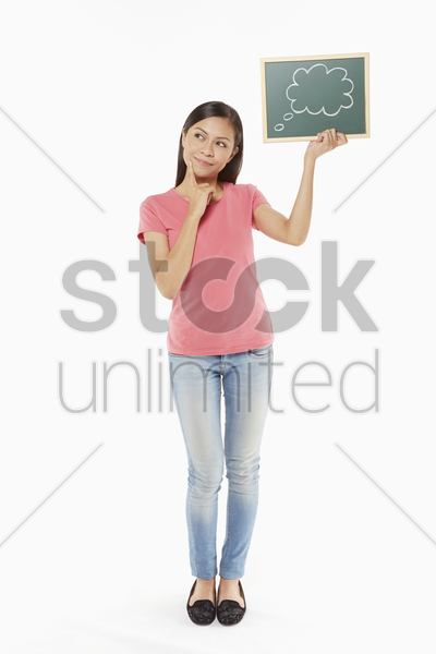 woman holding up small blackboard with a speech bubble doodle stock photo