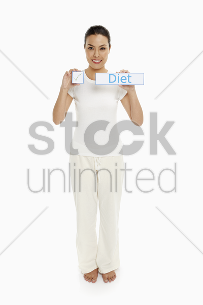 woman holding up small placards stock photo