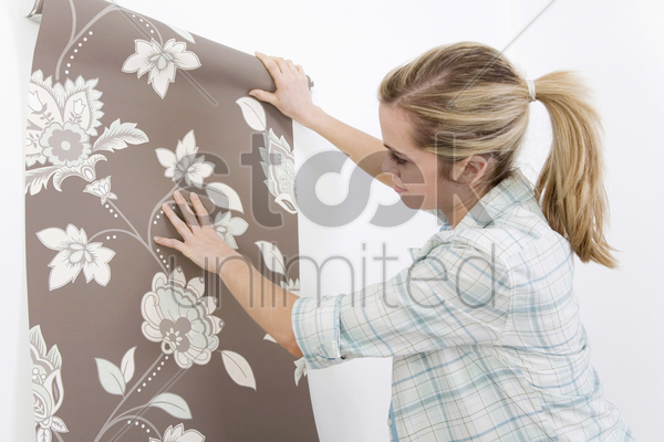 woman holding wallpaper stock photo