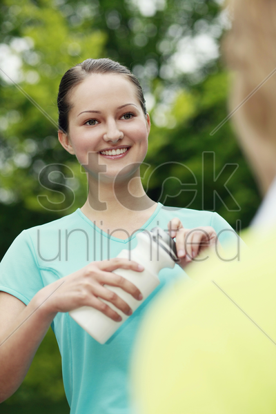 woman holding water bottle stock photo