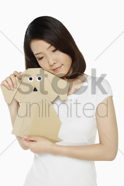 woman hugging a paper dog stock photo