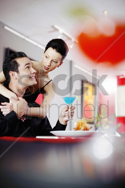 woman hugging her boyfriend from the back stock photo
