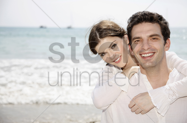 woman hugging man from the back stock photo