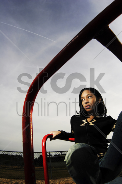 woman in a playground stock photo