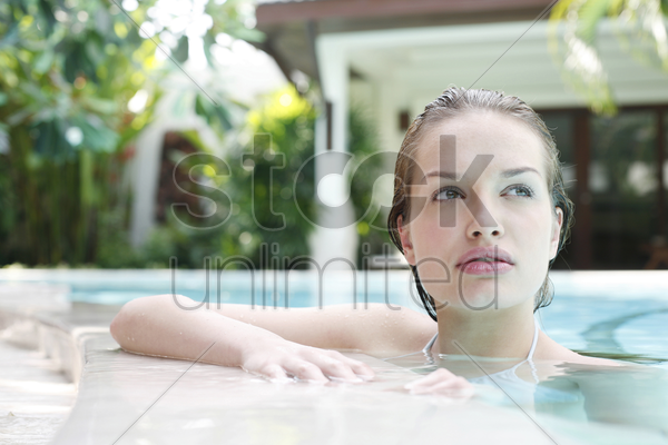 woman in a swimming pool stock photo