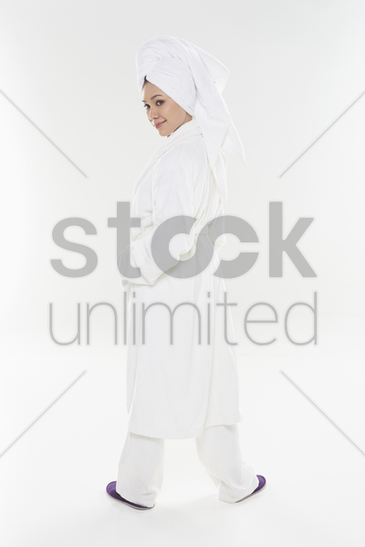 woman in bathrobe posing for the camera stock photo