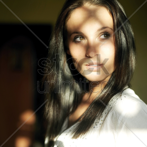 woman in deep thought stock photo