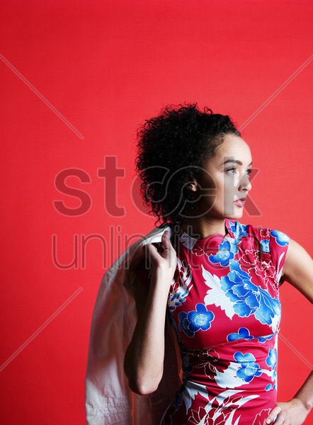 woman in floral dress posing for the camera stock photo