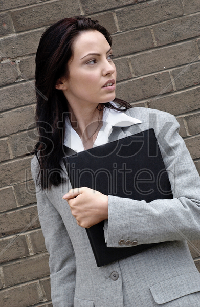 woman in formal wear holding a document stock photo