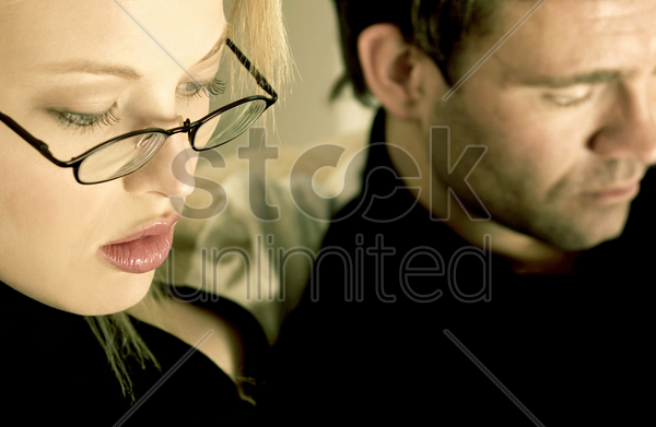 woman in glasses concentrating stock photo