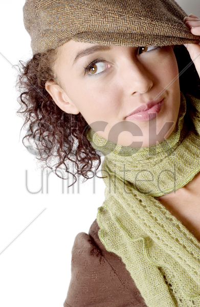 woman in hat looking up stock photo