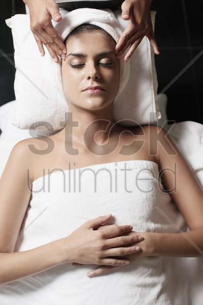 woman in health spa, having her face washed stock photo