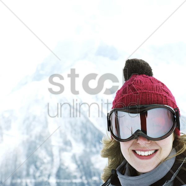 woman in knitted hat and ski goggles stock photo