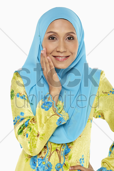 woman in malay traditional clothing, smiling stock photo