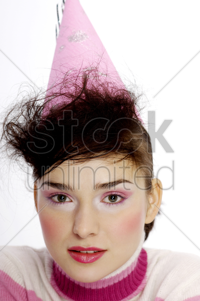 woman in party hat stock photo