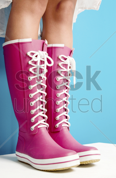 woman in pink boots stock photo