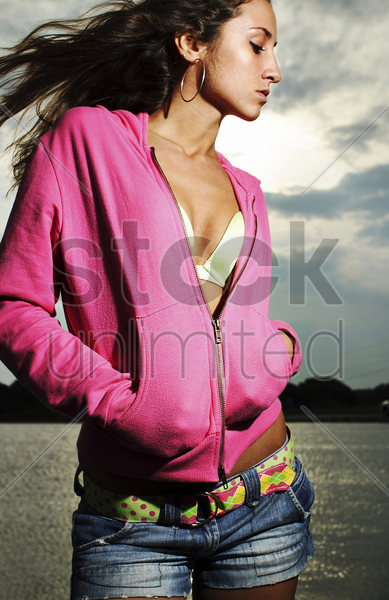 woman in pink jacket posing for the camera stock photo