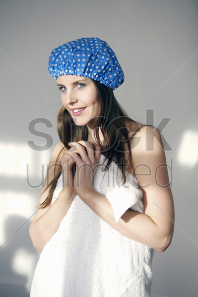 woman in shower cap and towel stock photo