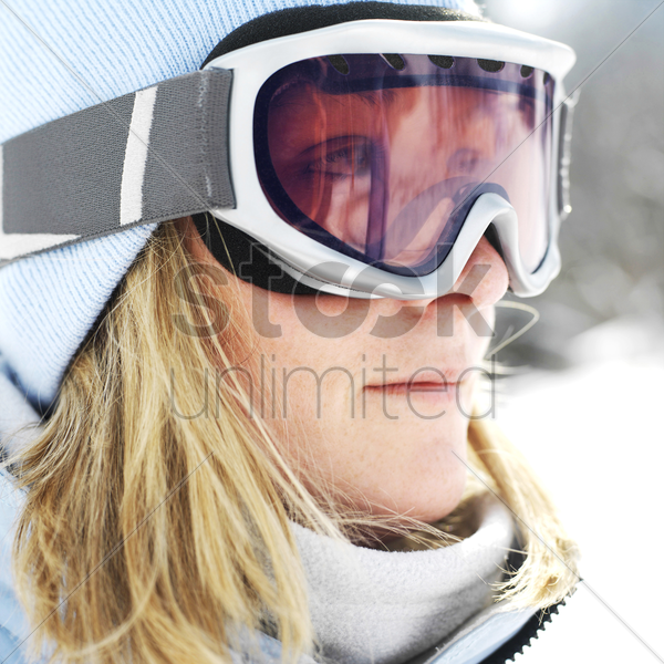 woman in ski goggles stock photo