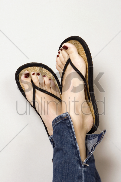woman in slippers, close-up stock photo