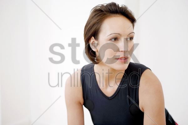 woman in sports clothing stock photo