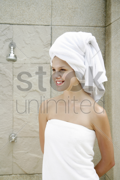 woman in towel smiling stock photo