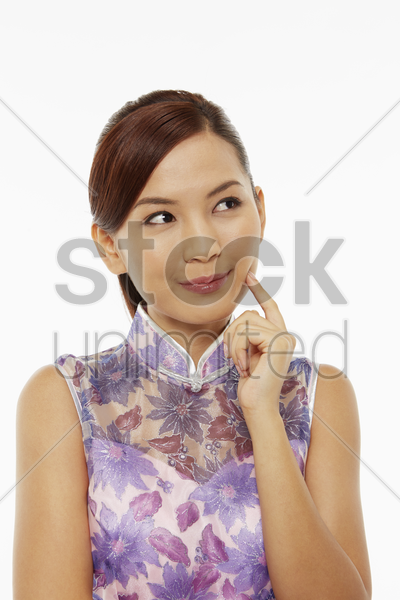 woman in traditional clothing contemplating stock photo