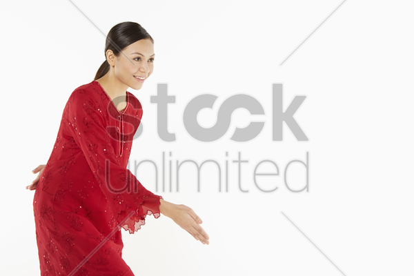 woman in traditional clothing excusing herself stock photo