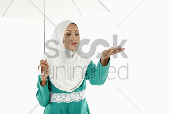 woman in traditional clothing holding an umbrella stock photo