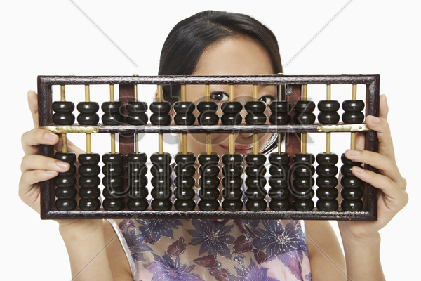 woman in traditional clothing holding up an abacus stock photo