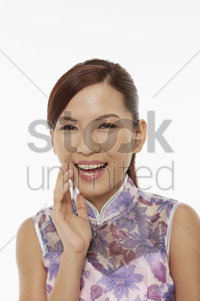 woman in traditional clothing laughing stock photo