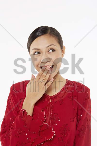 woman in traditional clothing looking surprised stock photo