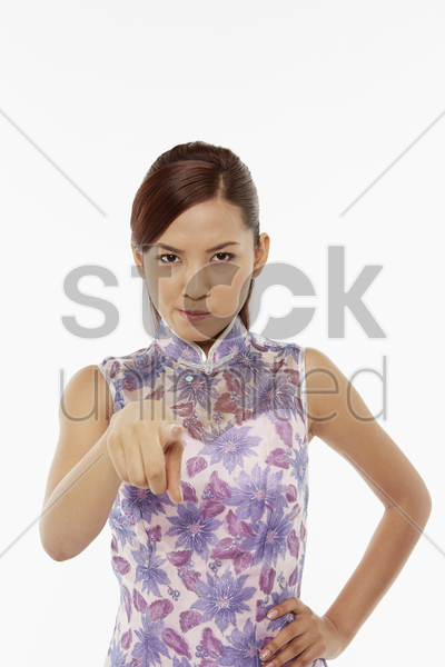 woman in traditional clothing pointing at the camera stock photo