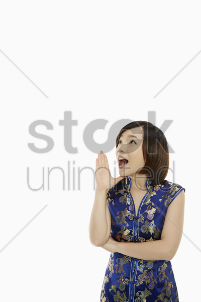 woman in traditional clothing shouting out stock photo