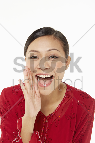 woman in traditional clothing shouting stock photo