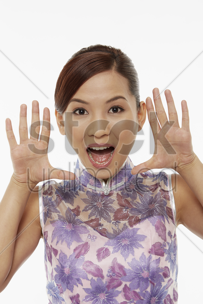 woman in traditional clothing showing hand gesture stock photo