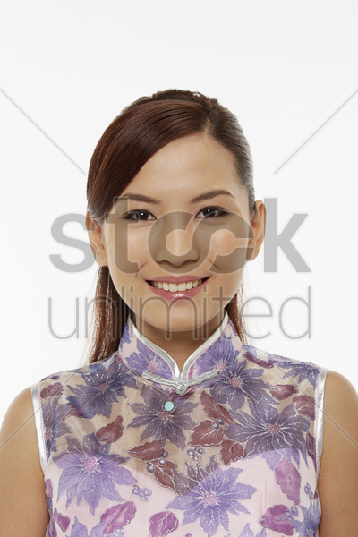 woman in traditional clothing smiling stock photo