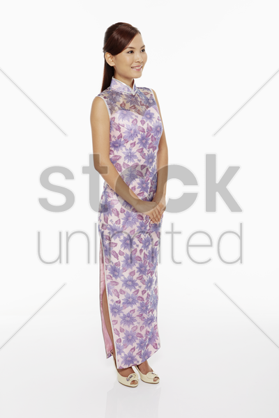 woman in traditional clothing standing and smiling stock photo