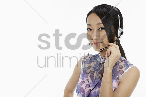 woman in traditional clothing with a headset stock photo