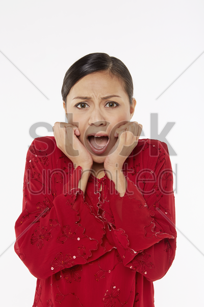 woman in traditional clothing with a scared expression stock photo