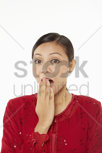 woman in traditional clothing with a shocked expression stock photo