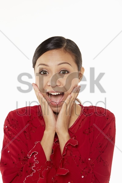 woman in traditional clothing with a surprised expression stock photo