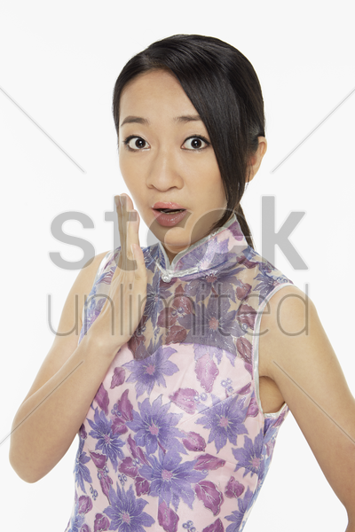 woman in traditional clothing with a surprised facial expression stock photo