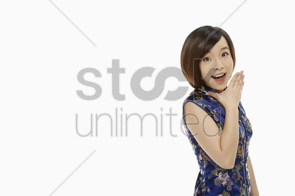 woman in traditional clothing with a surprised look on her face stock photo