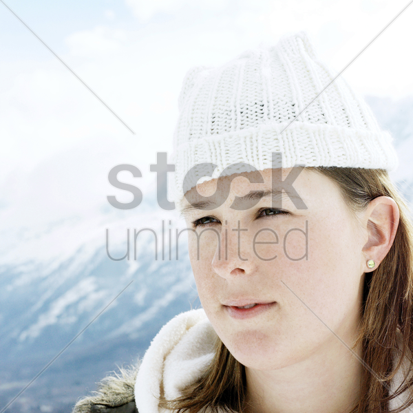 woman in white knitted hat in deep thought stock photo