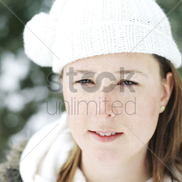 woman in white knitted hat stock photo