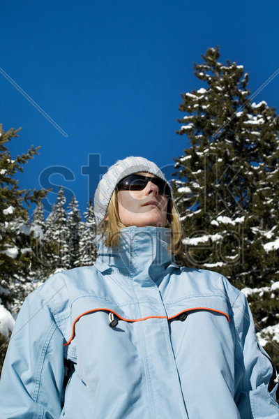woman in winter clothing stock photo